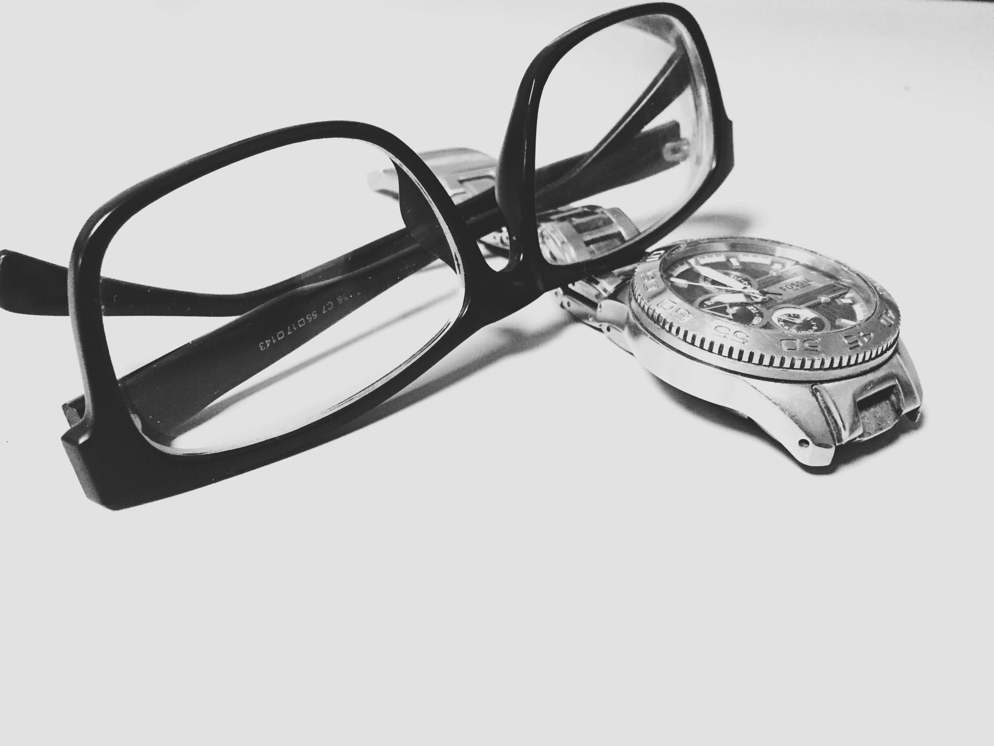 Classic reading glasses and watch